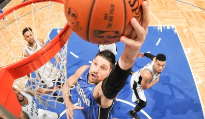 Nikola Vucevic takes it to the rim against the Nets in Orlando. (NBA.com)